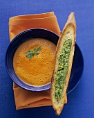Red pepper cream soup with pesto bruschetta