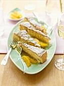 Pine nut cake garnished with orange segments