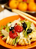 Spiral pasta with cherry tomatoes, rocket, olives & Parmesan