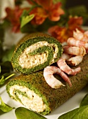 Nettle roulade with cottage cheese filling and shrimps