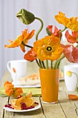 Orange poppies, orange wedges with pomegranate seeds