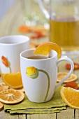 Orange tea and orange wedges