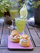 Profiteroles filled with salmon & dill cream, cucumber tonic