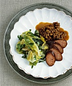 Braised lettuce with smoked sausage and lentils