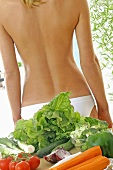 Fruit and vegetables in front of someone's bare back