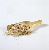 Wheat bran in wooden scoop