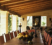 Bowl of fruit on dining table on roofed terrace