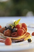 Mixed berry tart on fruit puree