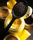 Mustard in jar and mustard seeds on spoon