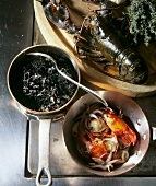 Lobster, black rice, lobster claws, squid