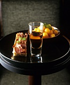 Spanish appetisers: ham on bread, melon balls and sherry