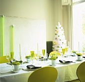 Festive table and artificial Christmas tree