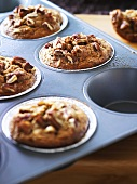 Wholemeal banana muffins in a muffin tin