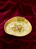 Cream of asparagus soup with scallops