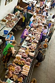 Various types of meat on a market stall in Ukraine