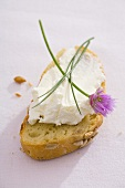 A slice of sunflower bread with quark and chives