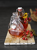 Rose hip liqueur in two bottles