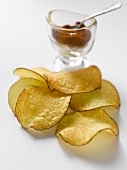 Crisps in front of glass of paprika