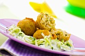 Deep-fried fish balls with cucumber salad