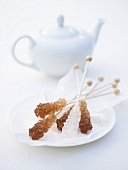 Sugar swizzle sticks and teapot