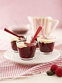 Red fruit compote and custard in glasses