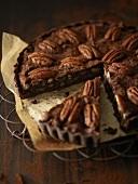Chocolate pecan tart, a piece cut