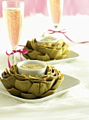 Artichokes with dip and champagne