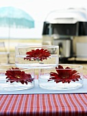 Gerbera flowers floating in small glass bowls