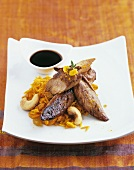 Roast duck fillet with rice, cashew nuts and caramel sauce