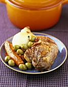 Duck with green olives, carrots and onions