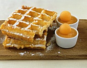 Waffles with icing sugar and frozen melon soup