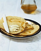 Beghrir (Moroccan pancakes) with butter and honey