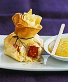 Brik pastry purse with scallop & tomato filling, curry sauce