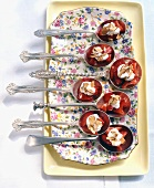 Appetisers on spoons: strawberries with cream and almonds