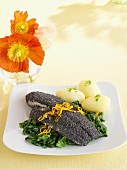 Sole fillet with poppy seed coating, spinach and potatoes