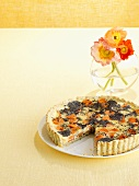 Carrot and poppy seed quiche, a piece removed