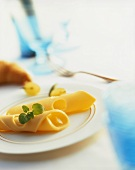 Cheese rolls on gold-rimmed plate