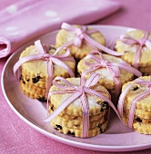 Biscuits tied together with pink gift ribbon