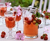 Strawberry drink with ice cubes, fresh strawberries & mallow
