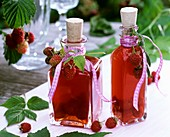 Raspberry vinegar with fresh raspberries
