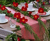 Grass plaits with roses (table decoration)