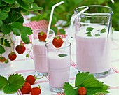 Strawberry shake in jug and glasses