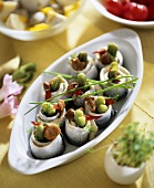 Herring rolls with gherkins and mushrooms