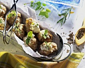 Baked potatoes with sheep's cheese, caraway seeds & herbs