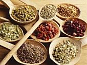 Assorted herbal teas on wooden spoons