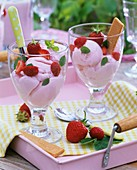 Strawberry ice cream with fresh strawberries and wafers