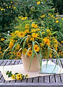 Vase of heliopsis, helenium and grasses