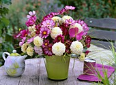 Arrangement of cosmos and dahlias