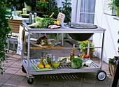 Barbecue trolley with fish, vegetables, tableware etc.