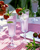 Mineral water with lemon verbena and strawberries
